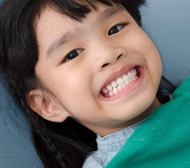 Child sharing smile after tooth colored filling restoration