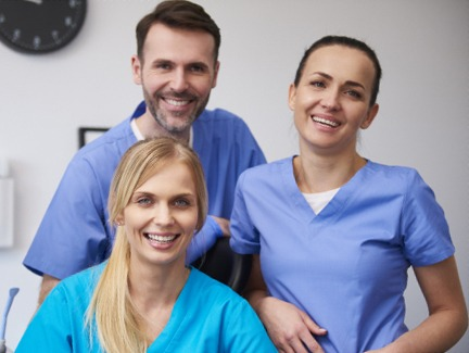 Doctor M. Kent Smith and his dental team